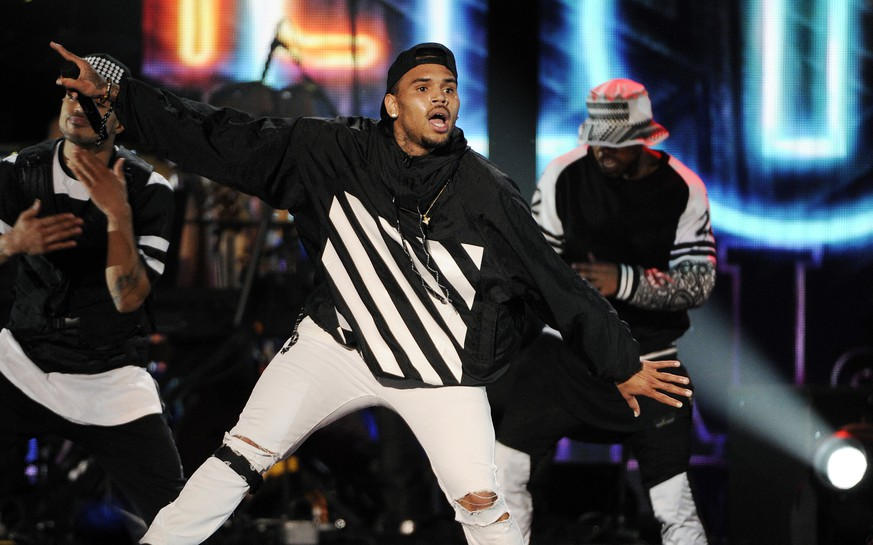 Singer Chris Brown performs during the 2014 Soul Train Awards at Orleans Arena on Friday, Nov. 7, 2014, in Las Vegas. (Photo by Chris Pizzello/Invision/AP)