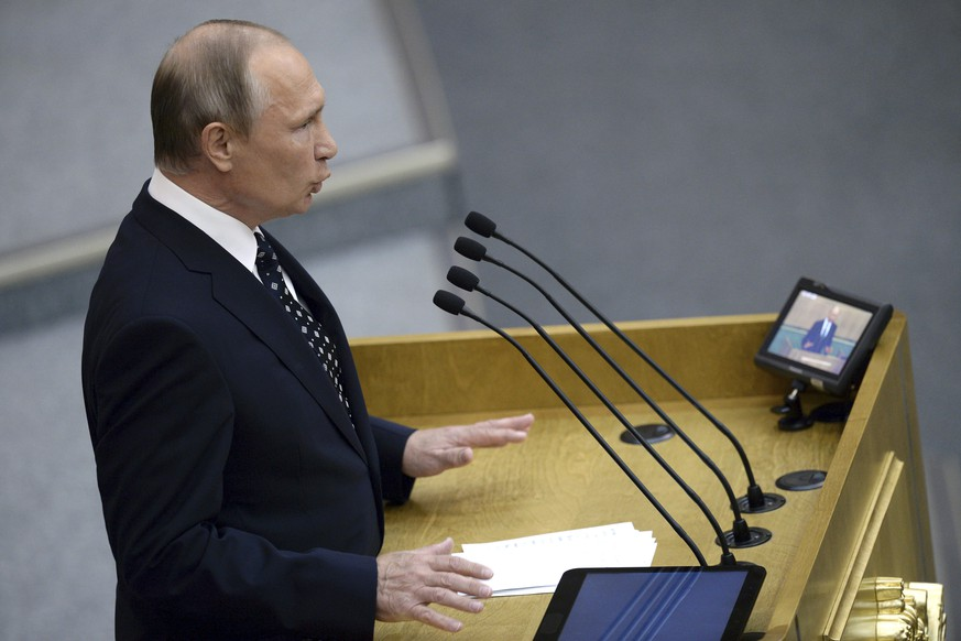 Russian President Vladimir Putin speaks at an opening session of the newly elected State Duma, Russia's lower house of parliament, in Moscow, Russia, Wednesday, Oct. 5, 2016. In his speech to members of the newly-elected lower house, Putin said the State Duma must help make Russia stronger. (Natalia Kolesnikova/Pool photo via AP)