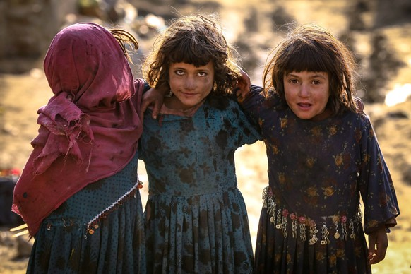 epa08831444 Afghan internally displaced children pose for a photograph as they play outside a temporary shelter on the occasion of Universal Children's Day in Kabul, Afghanistan on 20 November 2020. World Children's Day, originally called Universal Children's Day, is celebrated annually on 20 November since 1954 and promotes awareness among children worldwide as well as the improvement of children's welfare.  EPA/HEDAYATULLAH AMID