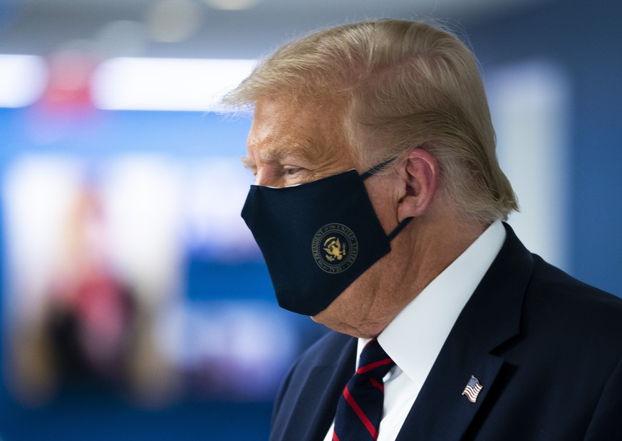 President Donald Trump wears a face mask as he tours the American Red Cross national headquarters in Washington, Thursday, July 30, 2020. (Doug Mills/The New York Times via AP, Pool)