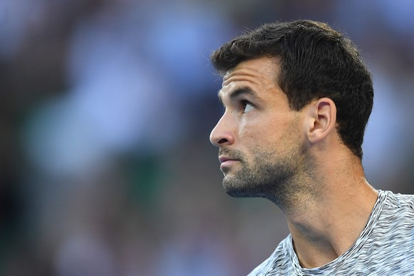 epa05753602 Grigor Dimitrov of Bulgaria reacts during his Men's Singles semifinal match against  Rafael Nadal of Spain at the Australian Open Grand Slam tennis tournament in Melbourne, Australia, 27 January 2017.  EPA/LUKAS COCH  AUSTRALIA AND NEW ZEALAND OUT