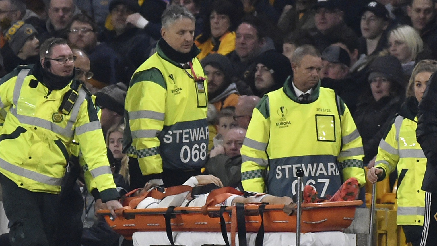 Slovan Bratislava's Kenan Bajric is carried from the pitch after injuring during the Europa League group K soccer match between Wolverhampton Wanderers and Slovan Bratislava at the Molineux Stadium, in Wolverhampton, England, Thursday, Nov. 7, 2019. (AP Photo/Rui Vieira)