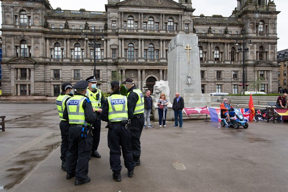 epa08512081 Police officers patrol on George Square following reports of a planned loyalist demonstration in Glasgow, Scotland, Britain, 27 June 2020. Only a very small group of loyalists sporting Union Jacks had so far congregated at the city's central square, which last week saw violent clashes during a peaceful demonstration on 20 June by anti-racism protesters and asylum-seekers who were attacked by militants of the far-right National Defence League (formerly known as the Scottish Defence League).  EPA/