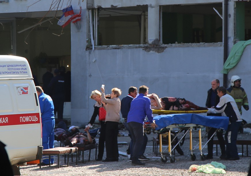 epa07099863 Rescuers work at a vocational school in Kerch in Crimea, 17 October 2018. About 18 people were killed and 40 injured in an suspected explosion and shooting in the school. According to the Russian Investigative Committee, an 18-year-old student has committed suicide after allegedly attacking the school.  EPA/KERCH.FM ATTENTION EDITORS: GRAPHIC CONTENT. ALTERNATIVE CROP
