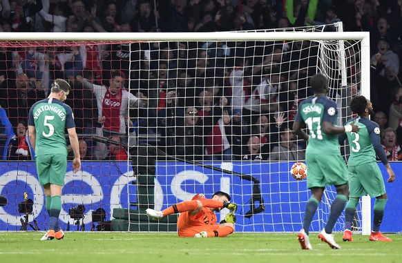 Tottenham goalkeeper Hugo Lloris, center, failing to stop the goal scored by Ajax's Hakim Ziyech during the Champions League semifinal second leg soccer match between Ajax and Tottenham Hotspur at the Johan Cruyff ArenA in Amsterdam, Netherlands, Wednesday, May 8, 2019. (AP Photo/Martin Meissner)