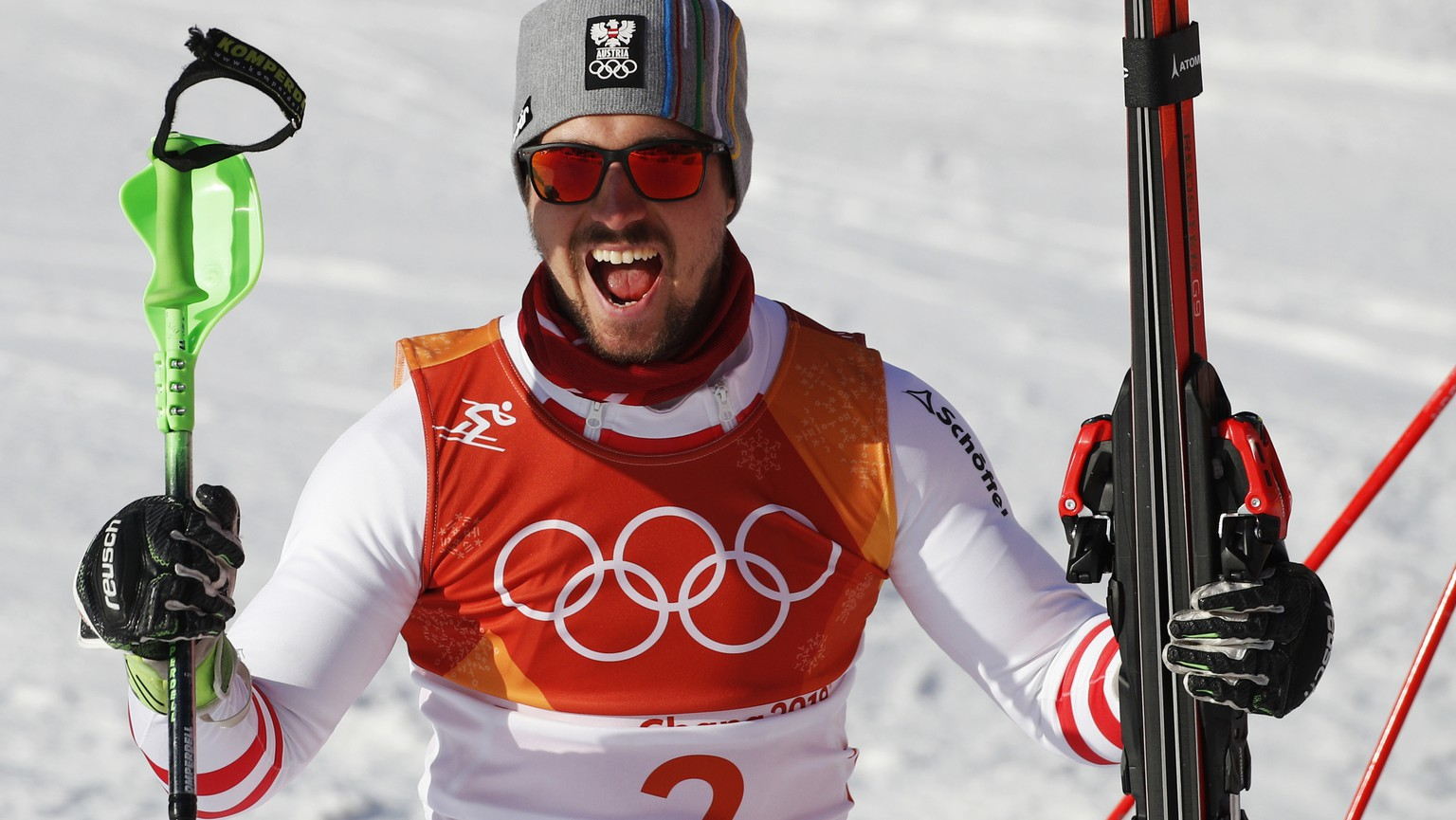 Austria's Marcel Hirscher celebrates after winning the gold medal in the men's combined at the 2018 Winter Olympics in Jeongseon, South Korea, Tuesday, Feb. 13, 2018. (AP Photo/Christophe Ena)