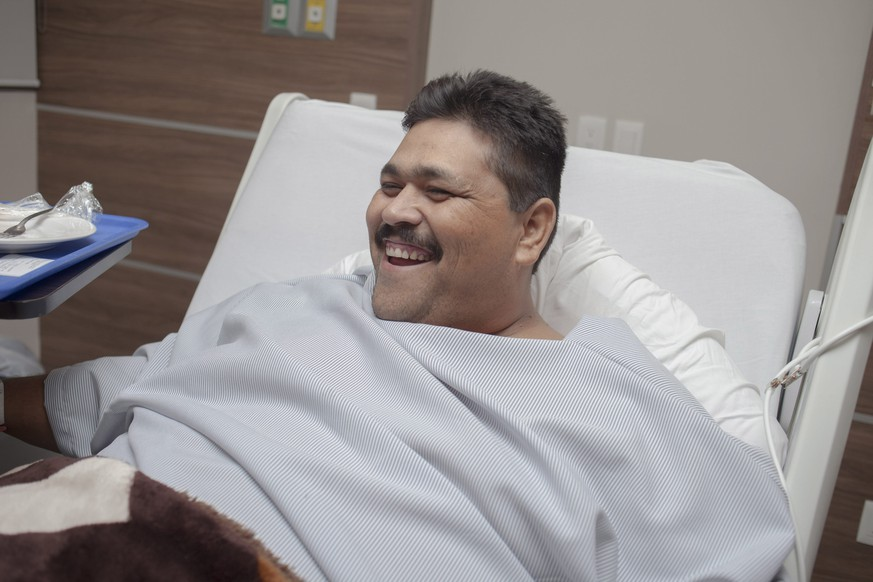 epa04999432 Andres Moreno, allegedly the world's heaviest man, smiles before having weight-reduction surgery, in Guadalajara, Mexico, 27 October 2015. Moreno, who weighs 435 kg (959 pounds), will undergo surgery at a Mexican hospital 28 October to reduce his weight that has confined him to bed with serious health risks. Just hours from the surgery, Moreno said he was looking forward to 'overcoming this step and be someone with a normal body.'  EPA/JHOEL ROD