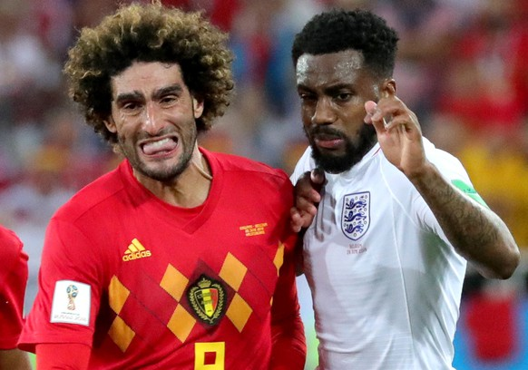 epa06848498 Marouane Fellaini of Belgium (L) and Danny Rose of England in action during the FIFA World Cup 2018 group G preliminary round soccer match between England and Belgium in Kaliningrad, Russia, 28 June 2018.  (RESTRICTIONS APPLY: Editorial Use Only, not used in association with any commercial entity - Images must not be used in any form of alert service or push service of any kind including via mobile alert services, downloads to mobile devices or MMS messaging - Images must appear as still images and must not emulate match action video footage - No alteration is made to, and no text or image is superimposed over, any published image which: (a) intentionally obscures or removes a sponsor identification image; or (b) adds or overlays the commercial identification of any third party which is not officially associated with the FIFA World Cup)  EPA/ARMANDO BABANI   EDITORIAL USE ONLY
