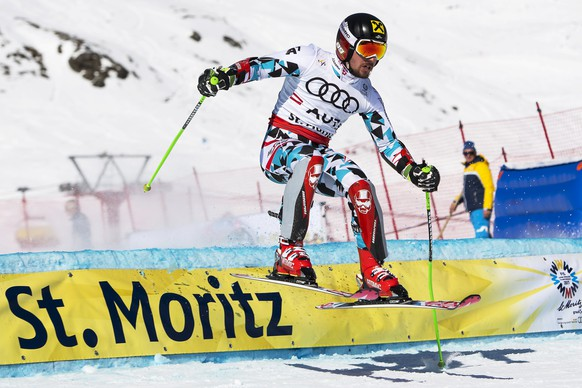 epa05792734 Marcel Hirscher of Austria in action during the round of 16 of the Nations Team Event at the 2017 FIS Alpine Skiing World Championships in St. Moritz, Switzerland, 14 February 2017.  EPA/JEAN-CHRISTOPHE BOTT
