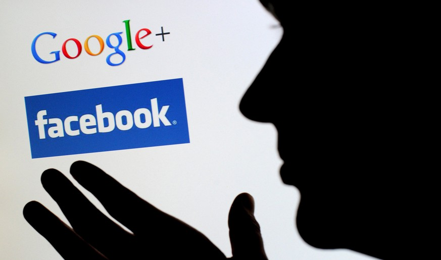 epa07079588 (FILE) - An image showing the profile of a person in front of a monitor, with logos of the social networks facebook and Google+ in Hanover, Germany, 21 September 2011 (reissued 08 October 2018). According to reports from 08 October 2018, Google will shut down large parts of its social media platform Google Plus after a major security breach. Google opened up its would-be Facebook rival Google Plus in 2011.  EPA/JULIAN STRATENSCHULTE  GERMANY OUT *** Local Caption *** 50049638
