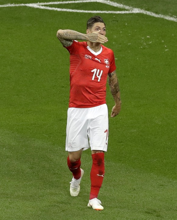 Switzerland's Steven Zuber celebrates his side's first goal during the group E match between Brazil and Switzerland at the 2018 soccer World Cup in the Rostov Arena in Rostov-on-Don, Russia, Sunday, June 17, 2018. (AP Photo/Andrew Medichini)