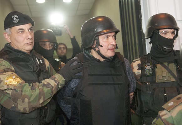 epa05365825 Former Public Works Secretary during the governments of the Argentine Presidents Nestor Kirchner and Cristina Fernandez de Kirchner, Jose Lopez (C) is escorted by members of the special police group Halcon in Buenos Aires, Argentina, 14 June 2016. Lopez was arrested by the police after reportedly trying to hide plastic bags containing a big quantity of money in a monastery in the city of General Rodriguez, near Buenos Aires. According to Buenos Aires' Province Security Minister Cristian Ritondo, the police seized from Lopez some 160 bundles of cash money in four currencies (US dollar, Euro, Yen and Qatari Riyal). According to local media, the amount of the seized money amounts to around seven million US dollar. Lopez is now investigated over alleged money laundering, media added.  EPA/STRINGER   EDITORIAL USE ONLY