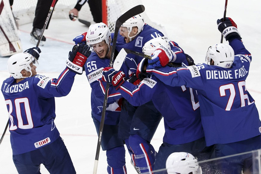 epa04745153 France's players celebrate their teammate Stephane Da Costa, 3rd left, than scored the winning goal during the shootout session of IIHF 2015 World Championship preliminary round game Latvia vs France, at the O2 Arena, in  Prague, Czech Republic, 12 May 2015.  EPA/SALVATORE DI NOLFI