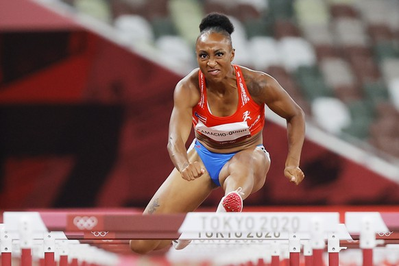 epa09385192 Jasmine Camacho-Quinn of Puerto Rico competes in the Women's 100m Hurdles semifinal at the Athletics events of the Tokyo 2020 Olympic Games at the Olympic Stadium in Tokyo, Japan, 01 August 2021.  EPA/VALDRIN XHEMAJ