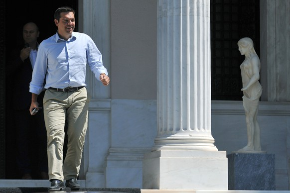Greek Prime Minister Alexis Tsipras leaves his office in Athens, on Thursday, Aug. 20, 2015. Tsipras has been contemplating his options after a parliament vote to approve the bailout conditions led to dozens of his own party lawmakers voting against him. Among the options being discussed are for him to call a vote of confidence in his government or to call an early election outright, potentially in September.(Giannis Kotsiaris/ InTime News via AP) GREECE OUT