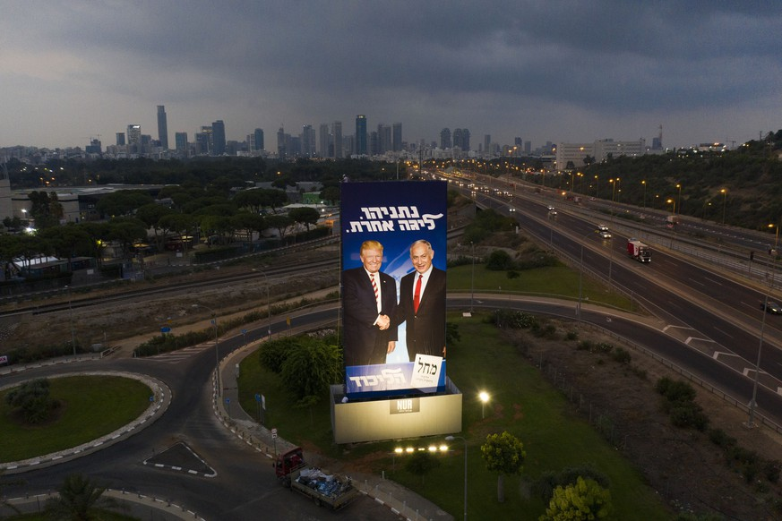 A massive election campaign billboard of the Likud party shows Israeli Prime Minister Benjamin Netanyahu, right, and US President Donald Trump in Tel Aviv, Israel, Sunday, Sept 8, 2019. Hebrew on the billboard reads