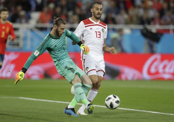 Spain goalkeeper David De Gea, kicks the ball next to Morocco's Khalid Boutaib during the group B match between Spain and Morocco at the 2018 soccer World Cup at the Kaliningrad Stadium in Kaliningrad, Russia, Monday, June 25, 2018. (AP Photo/Petr David Josek)