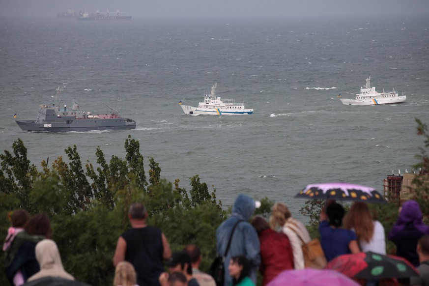 Ukrainian navy ships bob by the shore on a stormy, turbulent sea pass in Odessa's embankment, Ukraine, Sunday, Aug. 24, 2014. In another symbolic move, Poroshenko traveled south to the predominantly Russian-speaking port city of Odessa to give a second speech on Sunday. Ukraine lost much of its coastline when the Black Sea peninsula of Crimea was annexed by Russia in March, and the loyalty of local authorities in Odessa to Kiev has been a top priority for the new government. (AP Photo/Sergei Poliakov)