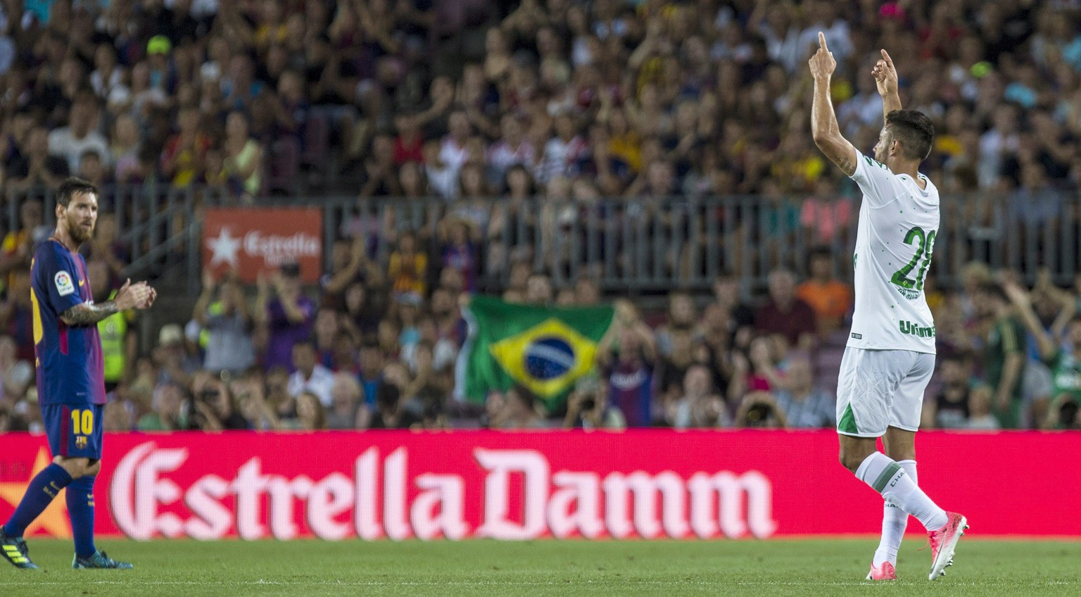 epa06130762 Chapecoense's Alan Ruschel (R) points at heaven during a Joan Gamper Trophy match between FC Barcelona and Chapecoense at the Camp Nou stadium in Barcelona, Catalonia, Spain, 07 August 2017.  EPA/Quique Garcia