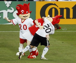 Germany's Lukas Podolski, right, celebrates his side's 3-2 win with Euro 2008 mascots Trix and Flix at the end of  the quarterfinal match between Portugal and Germany in Basel, Switzerland, Thursday, June 19, 2008, at the Euro 2008 European Soccer Championships in Austria and Switzerland. (AP Photo/Peter Klaunzer)
