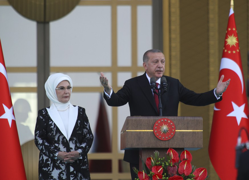 Turkey's President Recep Tayyip Erdogan, accompanied by his wife Emine, gestures as he talks during a ceremony at the Presidential Palace in Ankara, Turkey, Monday, July 9, 2018. Erdogan has been sworn in as Turkey's first president, following last month's elections under a new governing system that gives him sweeping executive powers. Critics say this leads to one-man rule.(AP Photo)