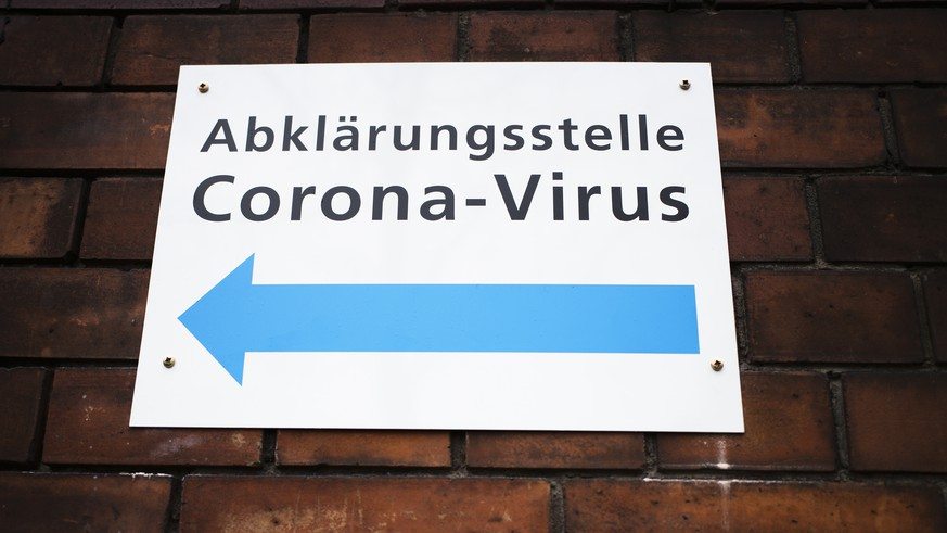 An information sign displayed at the wall of an hospital directing to a new set up test and information centre for the new coronavirus at the district Prenzlauer Berg in Berlin, Germany, Monday, March 9, 2020 (AP Photo/Markus Schreiber)