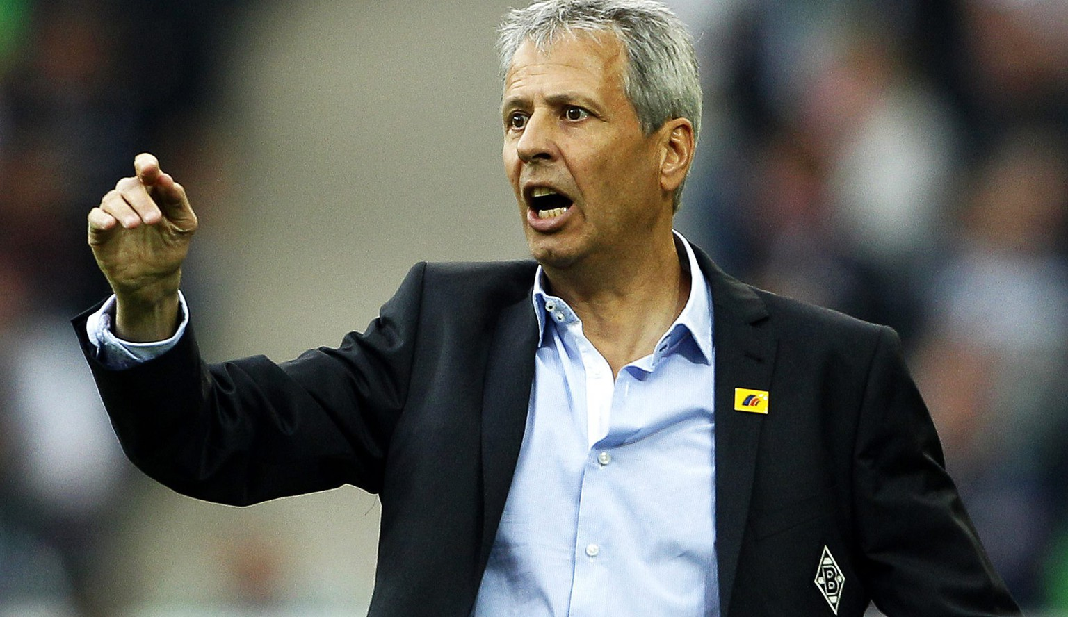 epa04399233 Moenchengladbach's Swiss head coach Lucien Favre reacts during the German Bundesliga soccer match between Borussia Moenchengladbach and FC Schalke 04 at Borussia-Park in Moenchengladbach, Germany, 13 September 2014.  EPA/ROLAND WEIHRAUCH (ATTENTION: Due to the accreditation guidelines, the DFL only permits the publication and utilisation of up to 15 pictures per match on the internet and in online media during the match.)