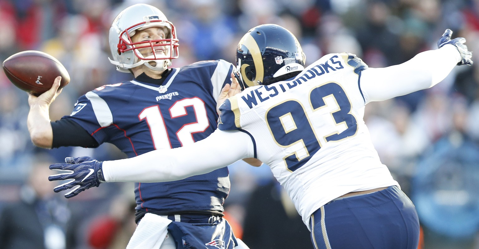 Dec 4, 2016; Foxborough, MA, USA;  New England Patriots quarterback Tom Brady (12) makes a pass as Los Angeles Rams defensive end Ethan Westbrooks (93) defends during the third quarter at Gillette Stadium. The Patriots won 26-10.  Mandatory Credit: Greg M. Cooper-USA TODAY Sports