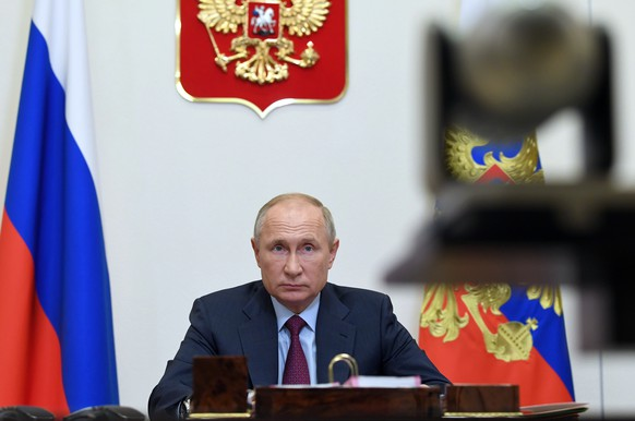 Russian President Vladimir Putin attends a meeting on coronavirus today at the Novo-Ogaryovo residence outside Moscow, Russia, Wednesday, Nov. 18, 2020. (Alexei Nikolsky, Sputnik, Kremlin Pool Photo via AP)