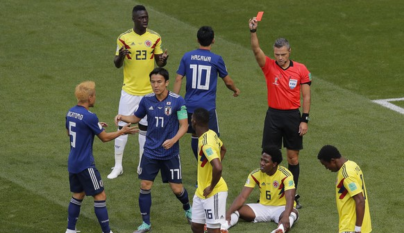 Referee Damir Skomina from Slovenia shows a red card to Colombia's Carlos Sanchez, on the ground, during the group H match between Colombia and Japan at the 2018 soccer World Cup in the Mordavia Arena in Saransk, Russia, Tuesday, June 19, 2018. (AP Photo/Vadim Ghirda)