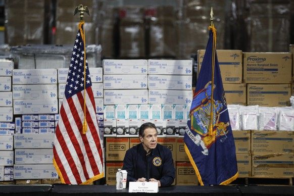 FILE - In this March 24, 2020, file photo New York Gov. Andrew Cuomo speaks during a news conference against a backdrop of medical supplies at the Jacob Javits Center that will house a temporary hospital in response to the COVID-19 outbreak in New York. (AP Photo/John Minchillo, File) Andrew Cuomo