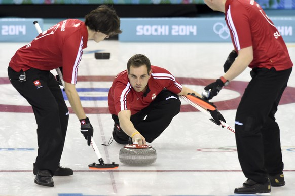 From left, Swiss Benoit Schwarz, skip Sven Michel and Simon Gempeler in action during the men's curling round robin game between Switzerland and Russia at the XXII Winter Olympics 2014 Sochi in Sochi, Russia, on Thursday, February 13, 2014. (KEYSTONE/Laurent Gillieron)