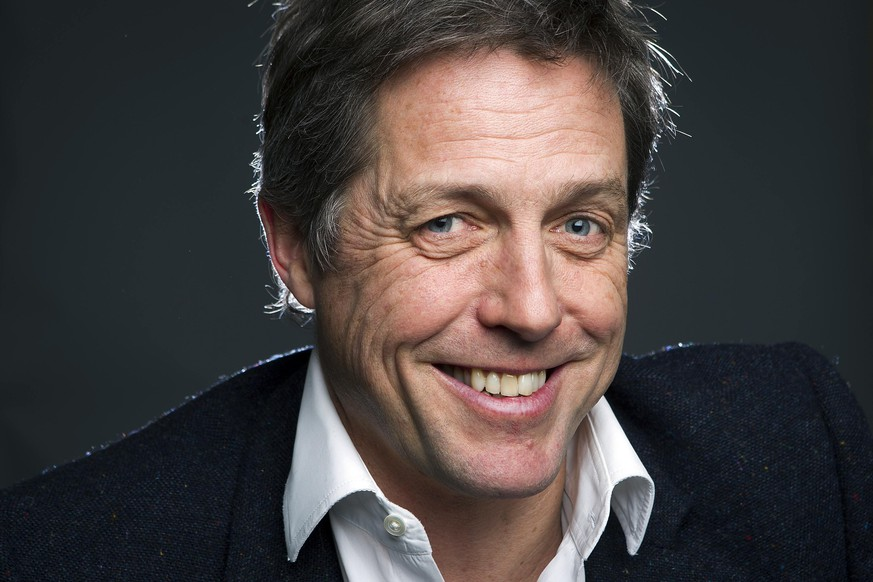 Actor Hugh Grant poses for a portrait as he promotes his movie