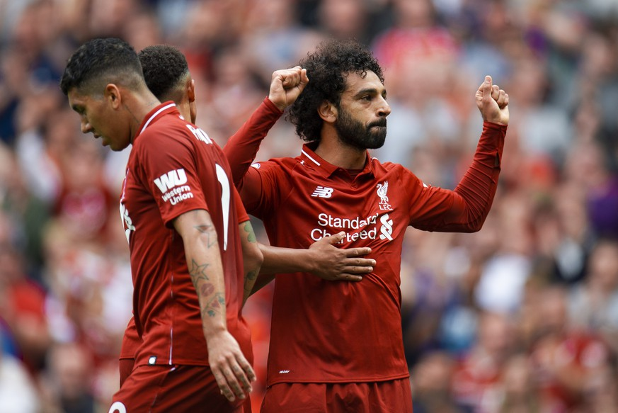 epa06945711 Liverpool's Mohamed Salah celebrates scoring the opening goal during the English Premier League soccer match between Liverpool and West Ham at the Anfield in Liverpool, Britain, 12 August 2018.  EPA/PETER POWELL