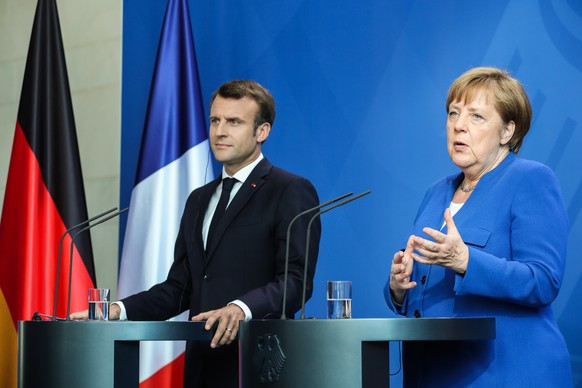 epa07536565 German Chancellor Angela Merkel (R) and French President Emmanuel Macron give a joint press statement during a 'Western Balkans Conference' at the Chancellery in Berlin, Germany, 29 April 2019. German Chancellor Angela Merkel and French President Emmanuel Macron are hosting a meeting of European Union officials and Western Balkan leaders to restart talks between Serbia and Kosovo.  EPA/HAYOUNG JEON