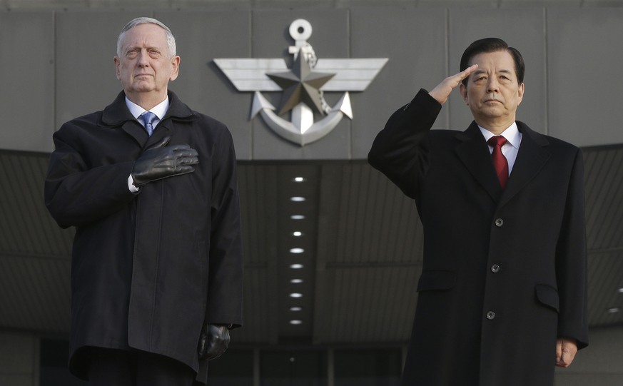 U.S. Defense Secretary Jim Mattis, left, and South Korean Defense Minister Han Min Koo salute during a welcome ceremony for Mattis at Defense Ministry in Seoul, South Korea, Friday, Feb. 3, 2017. (AP Photo/Ahn Young-joon)
