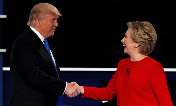 Republican U.S. presidential nominee Donald Trump and Democratic U.S. presidential nominee Hillary Clinton shake hands at the end of their first presidential debate at Hofstra University in Hempstead, New York, U.S., September 26, 2016. Picture taken September 26, 2016. REUTERS/Mike Segar