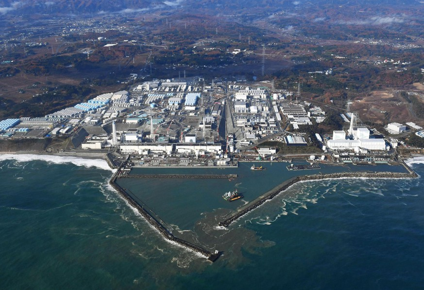 FILE - This Nov. 22, 2016, aerial file photo shows Fukushima Dai-ichi nuclear power plant in Okuma, Fukushima prefecture, Japan. A suspected wartime bomb was dug up at Thursday, Aug. 10, 2017, a construction site near the wrecked complex. The plant's operator, Tokyo Electric Power Co., said that a worker spotted the suspected bomb early Thursday while digging the ground at a parking lot about 1 kilometer (0.6 mile) north of the reactors destroyed in the 2011 earthquake and tsunami. (Kyodo News via AP, File)