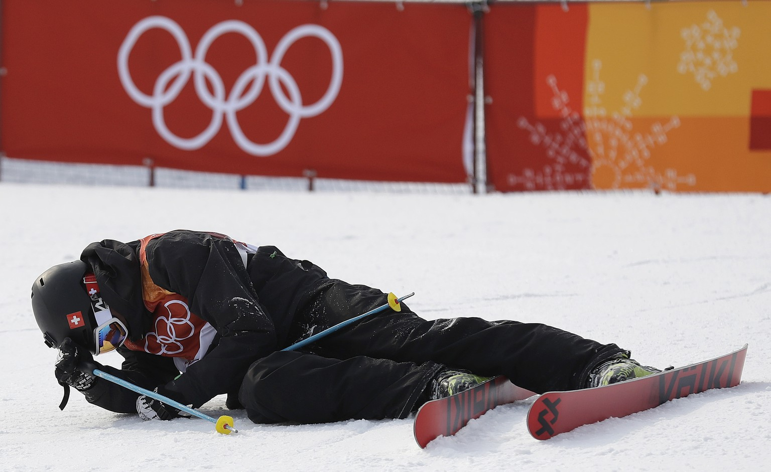Andri Ragettli, of Switzerland, sits on the course after crashing during the men's slopestyle final at Phoenix Snow Park at the 2018 Winter Olympics in Pyeongchang, South Korea, Sunday, Feb. 18, 2018. (AP Photo/Gregory Bull)
