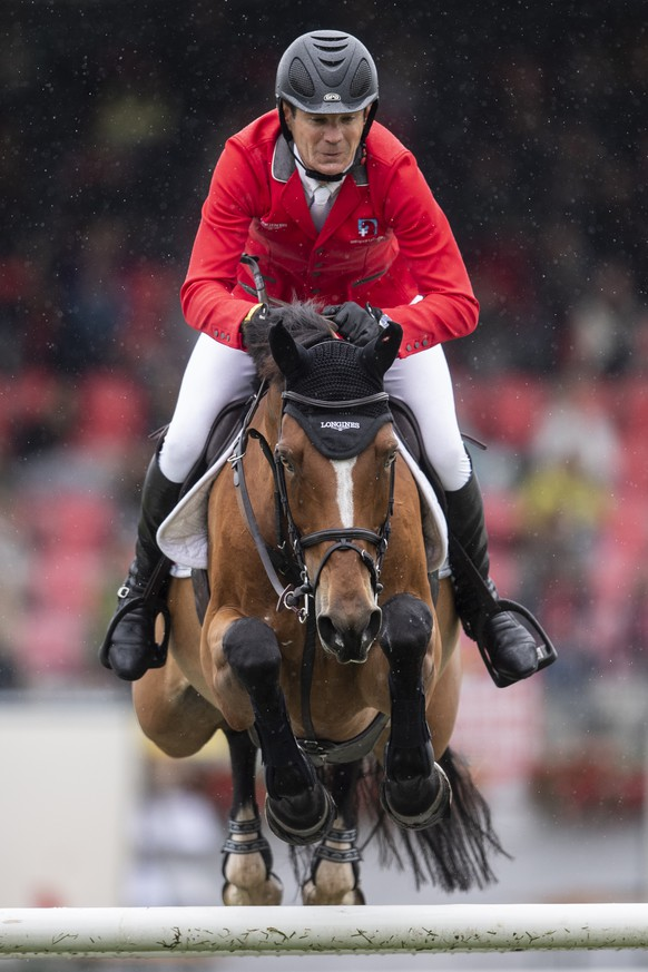 """Beat Mandli from Switzerland on Dsarie at the """"Longines FEI Jumping Nations Cup of Switzerland"""" during the CSIO Show Jumping in St. Gallen, Switzerland, Sunday, June 6, 2021. (KEYSTONE/Ennio Leanza)."""