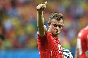 Switzerland's midfielder Xherdan Shaqiri celebrates their victory after a Group E football match between Honduras and Switzerland at the Amazonia Arena in Manaus during the 2014 FIFA World Cup on June 25, 2014. AFP PHOTO / RODRIGO ARANGUA