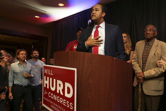 U.S. Rep. Will Hurd, R- Helotes running for Congress in District 23, talks with supporters as they watch the election results come in at the Eilan Hotel and Spa, Tuesday, Nov. 8, 2016. (Bob Owen/The San Antonio Express-News via AP)
