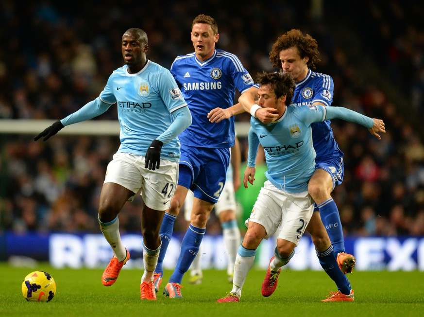 MANCHESTER, ENGLAND - FEBRUARY 03:  David Luiz of Chelsea grabs hold of David Silva of Manchester City as Yaya Toure of Manchester City and Nemanja Matic of Chelsea compete for the ball during the Barclays Premier League match between Manchester City and Chelsea at Etihad Stadium on February 3, 2014 in Manchester, England.  (Photo by Shaun Botterill/Getty Images)