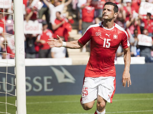 epa05333890 Switzerland's Blerim Dzemaili, celebrates after scoring a goal during an international friendly soccer match between Switzerland and Belgium, at the stade de Geneve stadium, in Geneva, Switzerland, 28 May 2016. Switzerland and Belgium are preparing for UEFA Euro 2016 soccer championships taking place from 10 June to 10 July 2016 in France.  EPA/JEAN-CHRISTOPHE BOTT