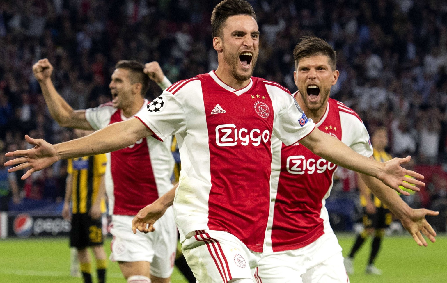 epa07032831 Nicolas Tagliafico (L) of Ajax celebrates with teammate Klaas Jan Huntelaar after scoring the 1-0 during the UEFA Champions League group E soccer match between Ajax Amsterdam and AEK Athens at Johan Cruijff Arena in Amsterdam, Netherlands, 19 September 2018.  EPA/OLAF KRAAK