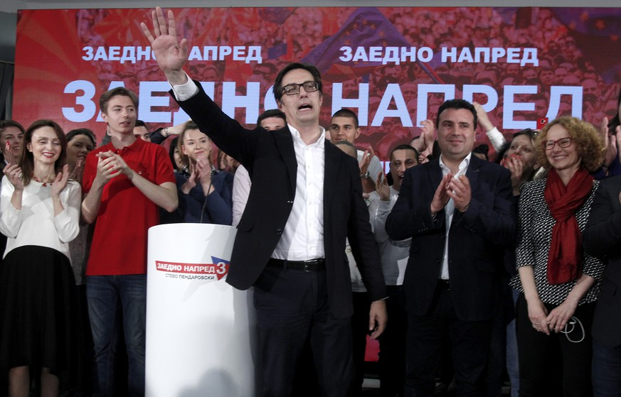 Stevo Pendarovski, center, a presidential candidate of the ruling coalition led by the Social-democrats, celebrate his victory in the presidential election, in Skopje, North Macedonia, late Sunday, May 5, 2019. Partial returns in North Macedonia's runoff presidential election Sunday show the pro-government candidate, Stevo Pendarovski, leading his conservative rival by about 9 percent in a vote seen as a test of the center-left government's pro-West policies despite the largely ceremonial duties of the country's head of state. (AP Photo/Boris Grdanoski)