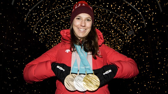 Wendy Holdener of Switzerland poses with the Gold, Silver and Bronze medals at the House of Switzerland after the Alpine Skiing Team event during the XXIII Winter Olympics 2018 in Pyeongchang, South Korea, Saturday, February 24, 2018. (KEYSTONE/Jean-Christophe Bott)