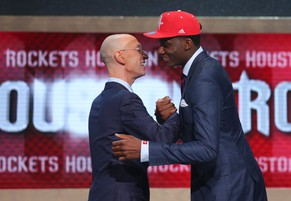 Jun 26, 2014; Brooklyn, NY, USA; Clint Capela (Switzerland) shakes hands with NBA commissioner Adam Silver after being selected as the number twenty-five overall pick to the Houston Rockets in the 2014 NBA Draft at the Barclays Center. Mandatory Credit: Brad Penner-USA TODAY Sports