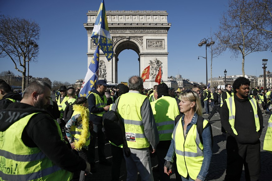 epa07389890 Protesters from the 'Gilets Jaunes' (Yellow Vests) movement gather at the Champs Elysees as they take part in the 'Act XV' demonstration (the 15th consecutive national protest on a Saturday) in Paris, France, 23 February 2019. The so-called 'gilets jaunes' (yellow vests) is a grassroots protest movement with supporters from a wide span of the political spectrum, that originally started with protest across the nation in late 2018 against high fuel prices. The movement in the meantime also protests the French government's tax reforms, the increasing costs of living and some even call for the resignation of French President Emmanuel Macron.  EPA/YOAN VALAT