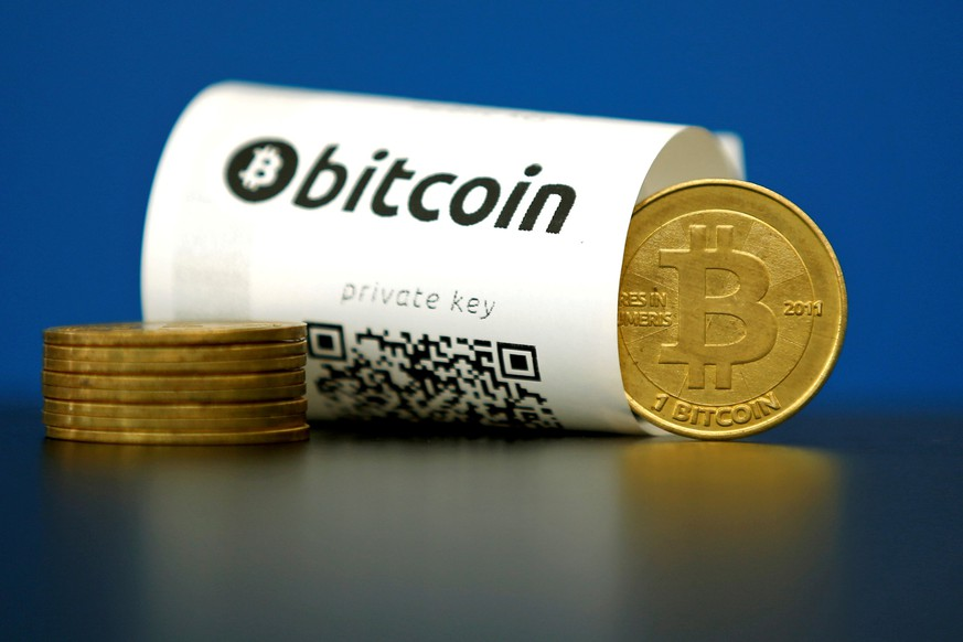 FILE PHOTO - A Bitcoin (virtual currency) paper wallet with QR codes and a coin are seen in an illustration picture taken at La Maison du Bitcoin in Paris, France, May 27, 2015. To match Special Report BITCOIN-WRIGHT/PATENTS     REUTERS/Benoit Tessier/File Photo